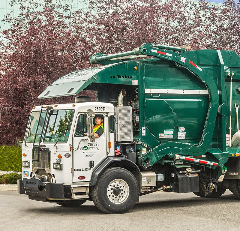 Photo of Alaska Waste Commercial Service truck and driver.