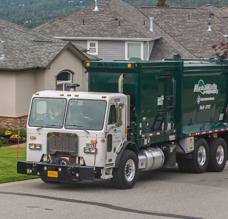 Photo of Alaska Waste Residential Services Truck outside of a home.